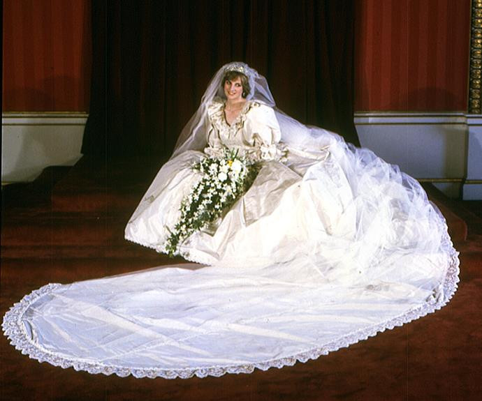**Princess Diana, 29 July 1981** <br><br> Princess Diana and Prince Charles wed on July 29, 1981 at St Paul's Cathedral with the lavish affair televised and watched by an estimated 750 million people. <br><br> The Princess of Wales wore an ivory silk taffeta designed by David and Elizabeth Emanuel which featured hand-embroidered tiny mother-of-pearl sequins and pearls. <br><br> It also featured lace that had belonged to Queen Mary on the bodice and was finished with a long train and an ivory silk tulle veil, held by the Spencer family's diamond tiara.