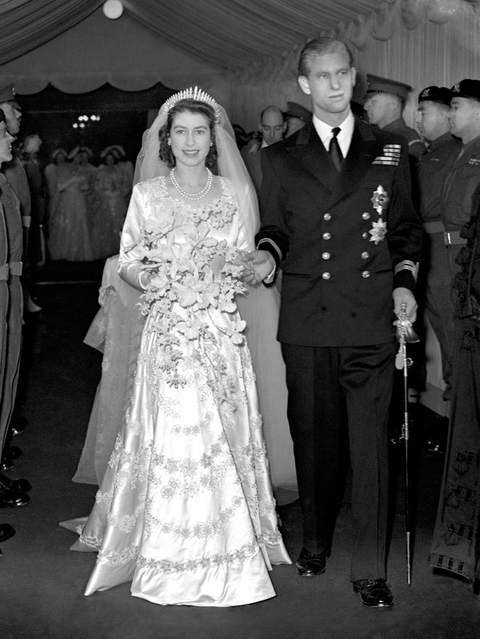 **Princess Elizabeth, 20 November 1947** <br><br> Before she became Queen, Princess Elizabeth married Prince Philip at Westminster Abbey on November 20,1947. <br><br> Elizabeth's beautiful wedding gown was hand-embroidered with more than 10,000 pearls and crystals and designed by Sir Norman Hartnell, who cited Boticelli's painting Primavera as his inspiration. <br><br> Her skirt was made of Duchesse satin and her long sleeves were embroidered with garlands of roses in raised pearls entwined with ears of wheat in crystals and pearls. <br><br> A 14-foot-long ivory silk tulle train completed the gown, embroidered with rose and wheat motifs.