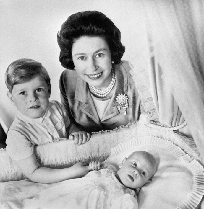 Four-year-old Prince Andrew with Queen Elizabeth and a newborn Prince Edward. *(Image: Getty)*