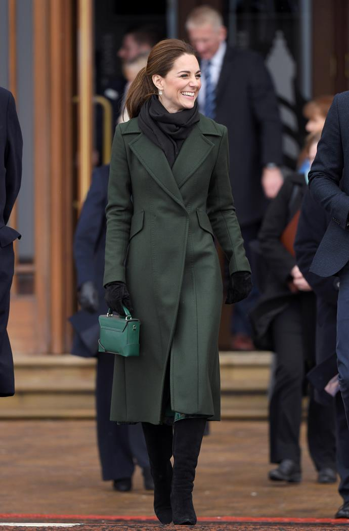 Kate looked elegant as usual, in her green Sportmax coat and Michael Kors dress. *(Image: Getty)*