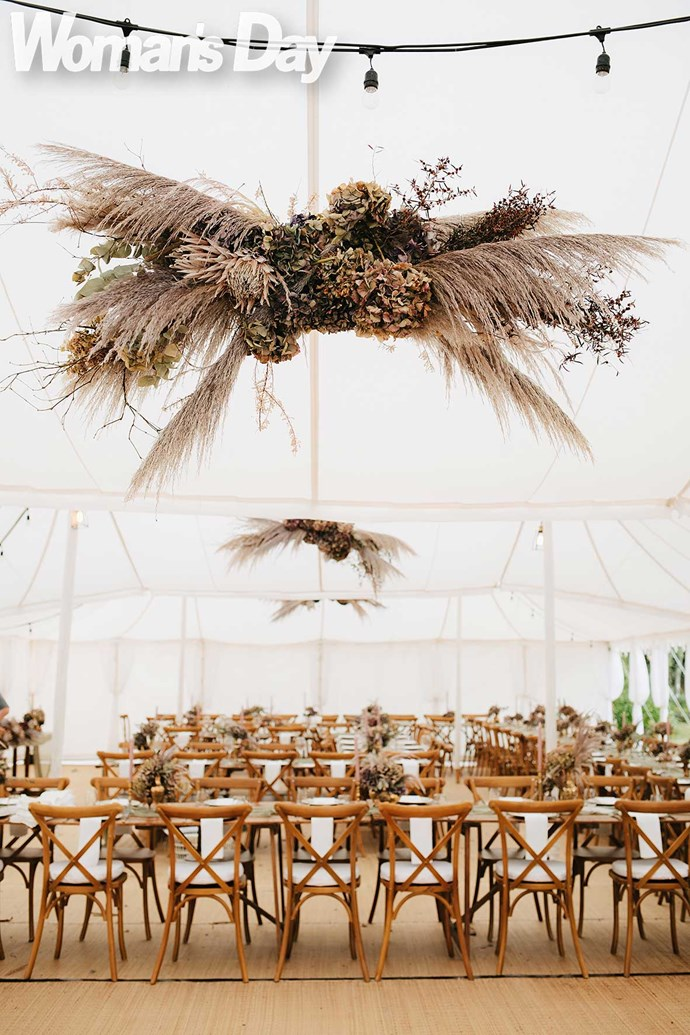 In the marquee, arrangements by Floral & Styling – Flower and Hunt amp up the romance.