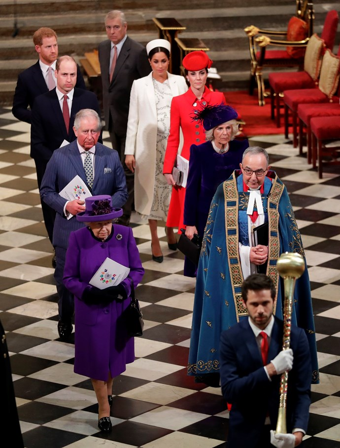 The Queen, dressed in a vibrant purple, led the royal family in the celebration. *(Image: Getty)*