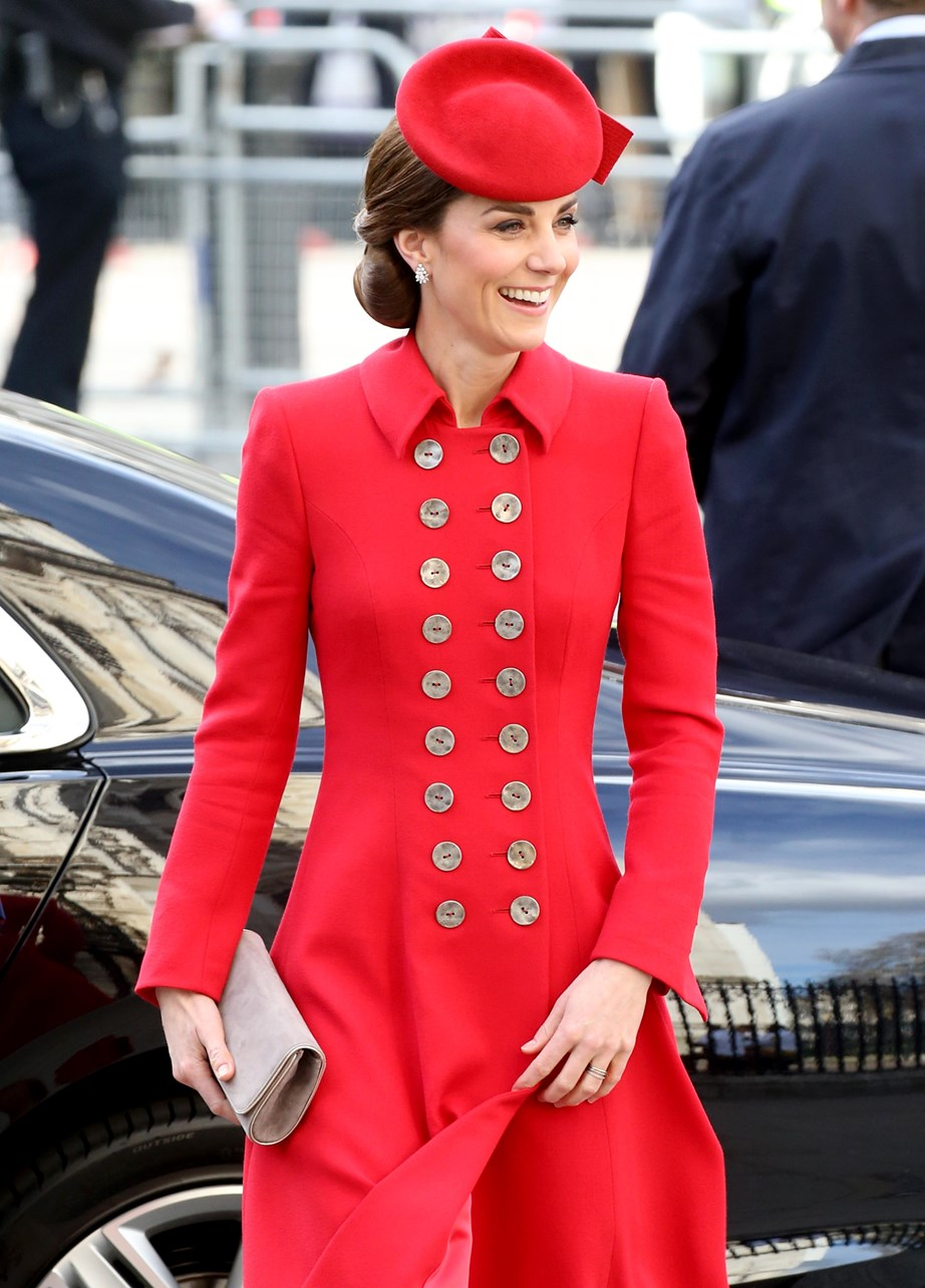 The Duchess of Cambridge looked radiant as she stepped out in a red Catherine Walker coat dress at the Commonwealth Day service at Westminster Abbey. *(Image: Getty)*