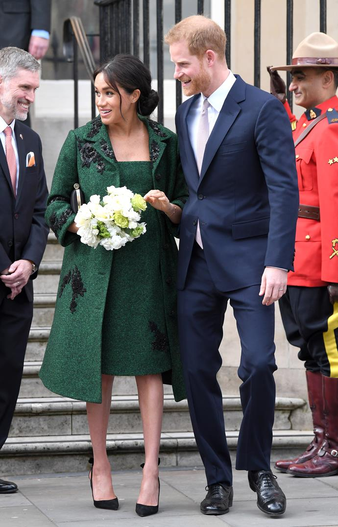 Meghan wore a beautiful green bespoke coat and dress by Erdem, which had a cute nod to both Canada and her mother, Doria Ragland. *(Image: Getty)*