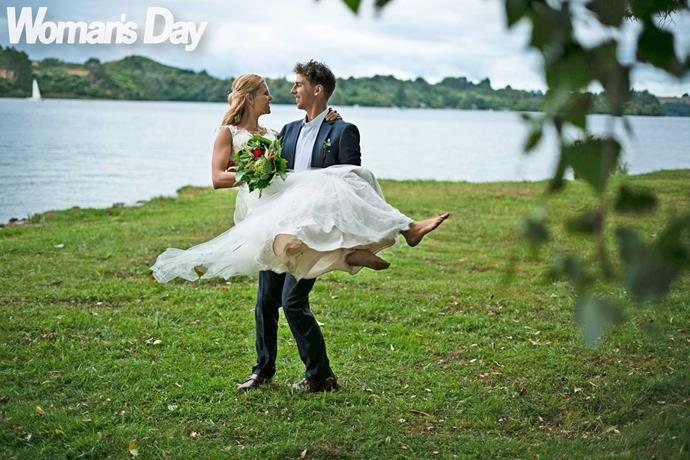 The gorgeous bride gets swept off her feet!