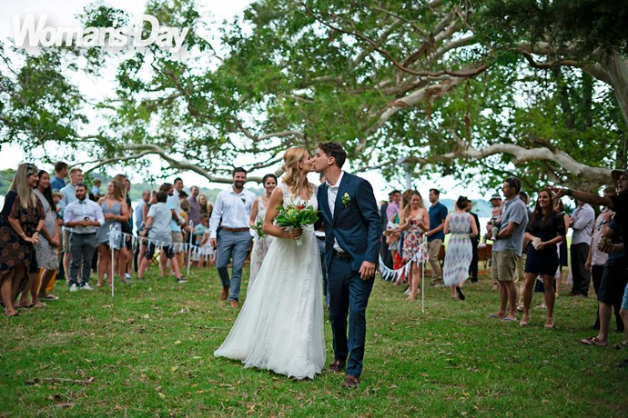 """Of their special lakeside ceremony, Mike says, """"We tried to put a little personal touch on everything."""""""