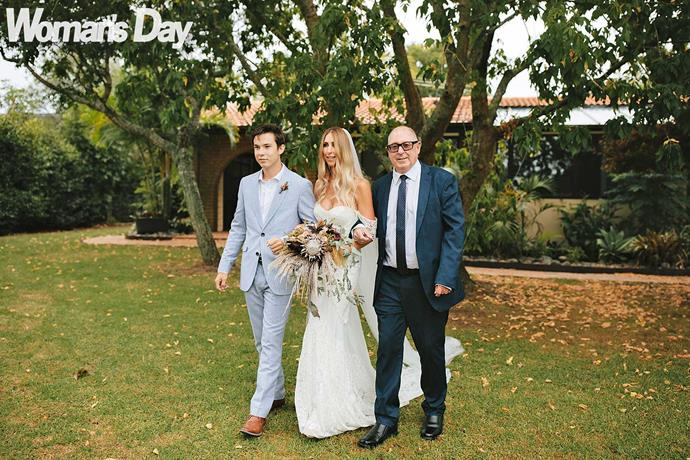 Son Ollie and her dad Ross take Kristie to her groom.