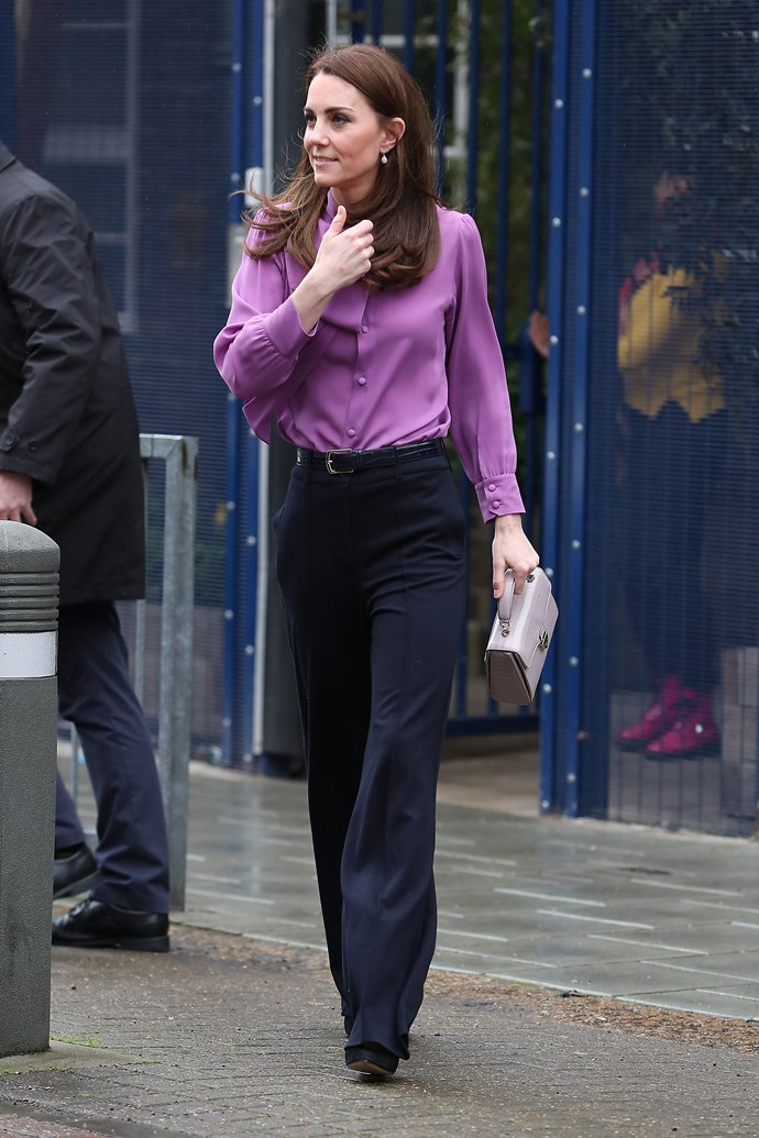 Kate stepped out in a chic purple Gucci blouse with black pants by Jigsaw. *(Image: Getty)*