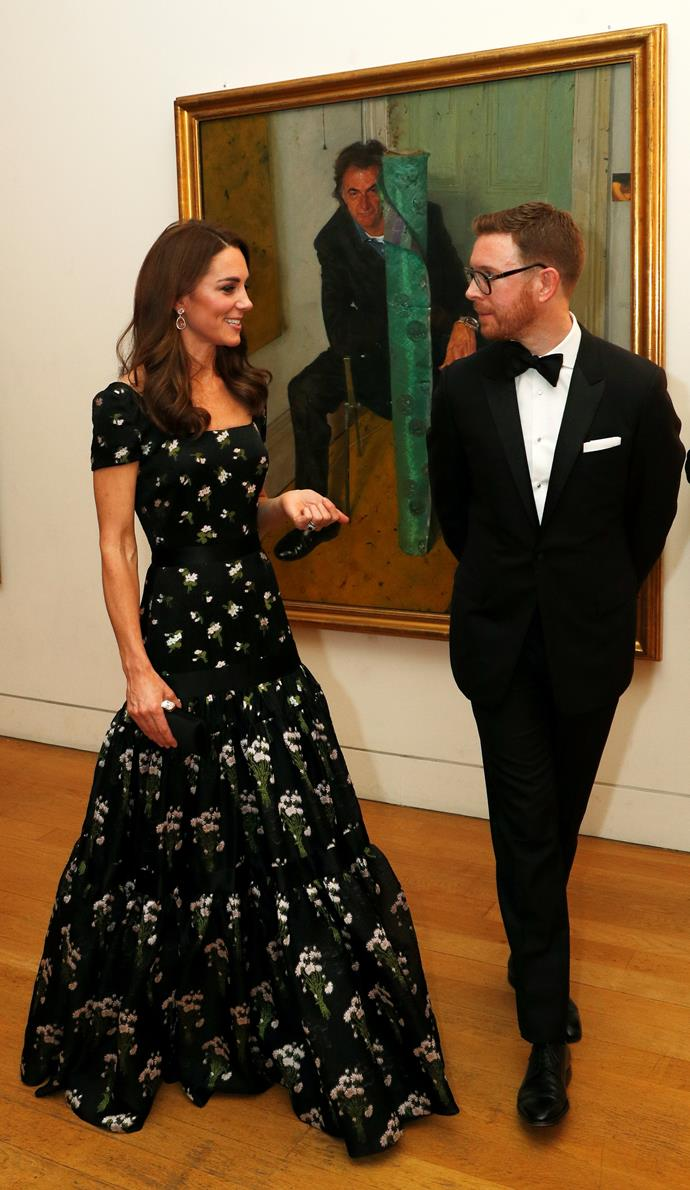 Kate speaks with Dr Nicholas Cullinan, Director of the National Portrait Gallery, of which she is Patron. *(Image: Getty)*