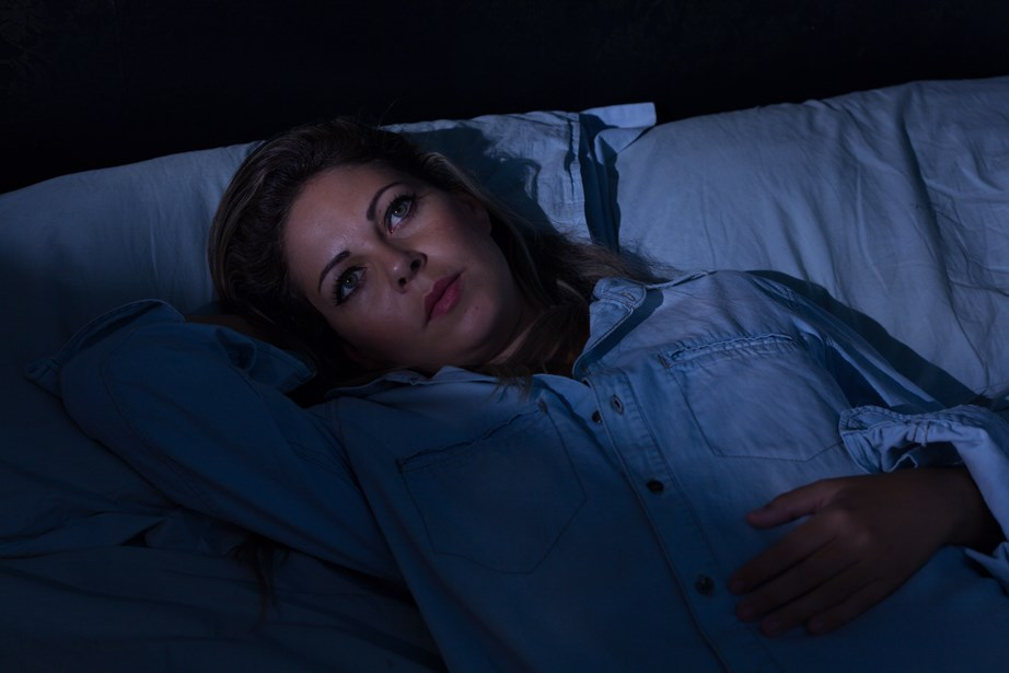 If you can't find the right waking time, you can also use a sleep-cycle alarm clock or app. These record the sleeper's movements, and are able to identify moments of waking or windows of light sleep. *(Image: Getty)*