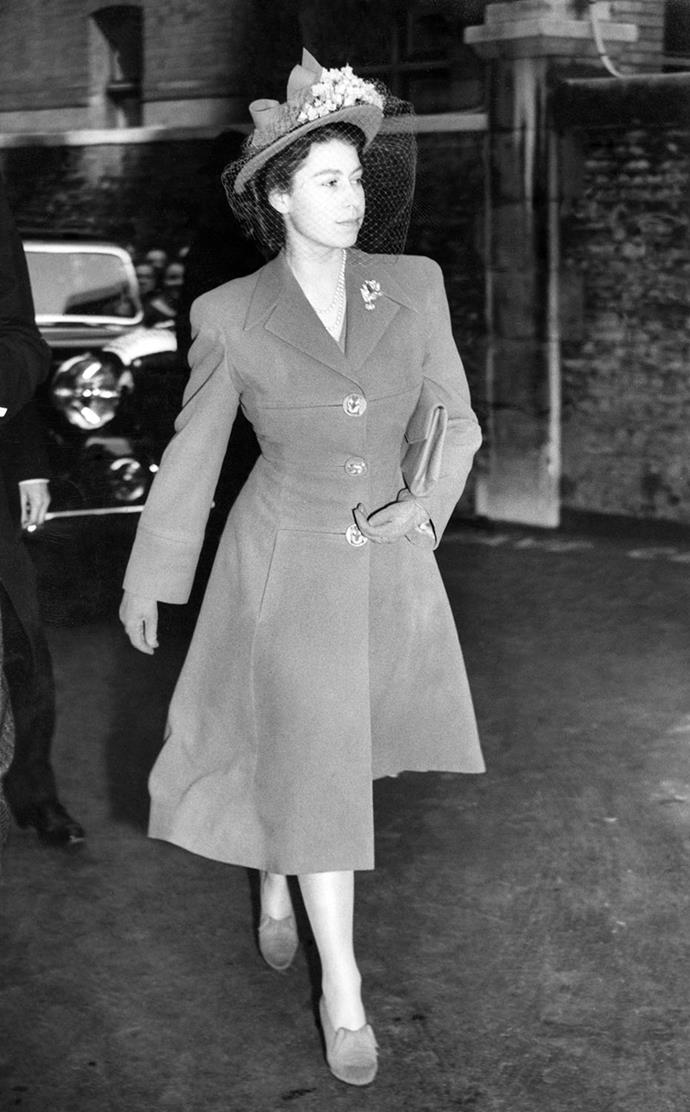 **Princess Elizabeth, 1948**  Before she was Queen, Elizabeth showed off a barely-there baby bump, while pregnant with her first child and heir to the throne, Prince Charles. *(Image: Getty)*
