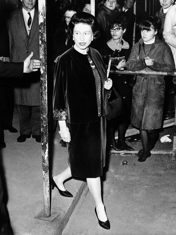 **Queen Elizabeth, 1963**  Queen Elizabeth looked stylish in velvet as she attended a ballet performance at the Covent Garden Opera, while five months pregnant with her youngest child, Prince Edward. *(Image: Getty)*