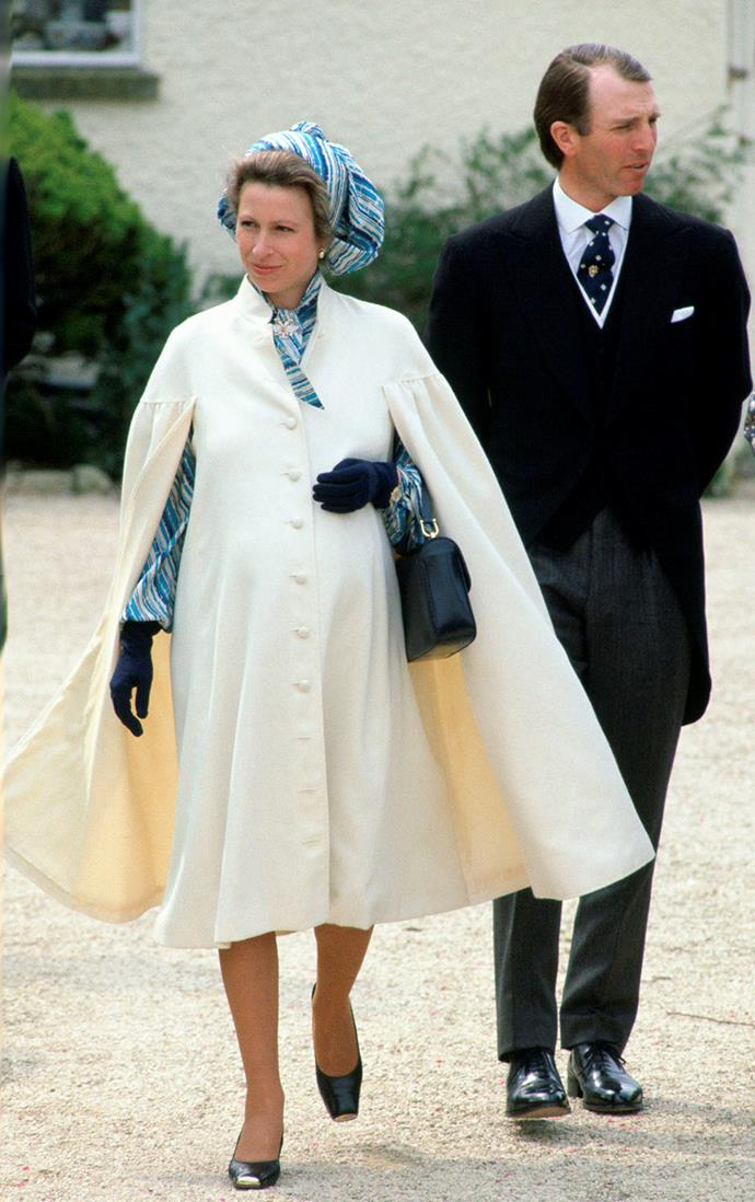 **Princess Anne, 1981**  Princess Anne looks radiant in a caped coat and vibrant dress, just weeks before the arrival of her daughter Zara Philips. *(Image: Getty)*