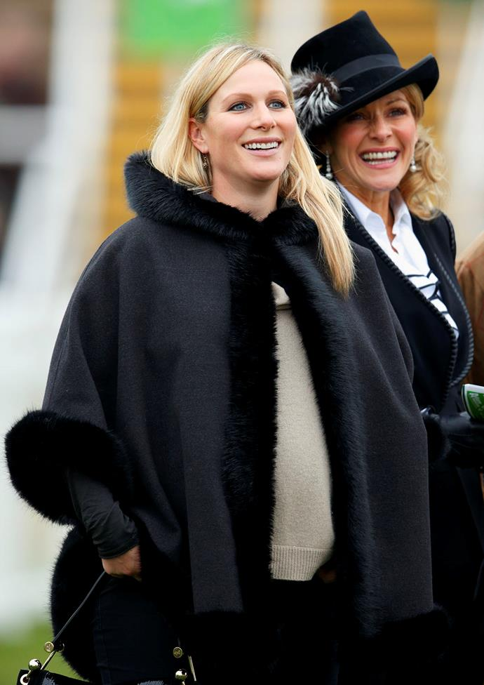 **Zara Tindall, 2013**  The Princess Royal's daughter, Zara, was all smiles as she rugged up in a black fur-lined coat and comfy sweater, while pregnant with her first child. *(Image: Getty)*