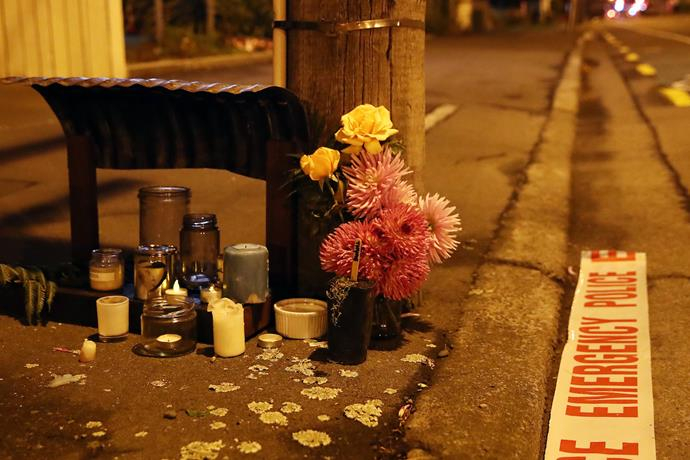Floral tributes are left before dawn at Deans Avenue near the Al Noor Mosque. *Photo: Getty Images*