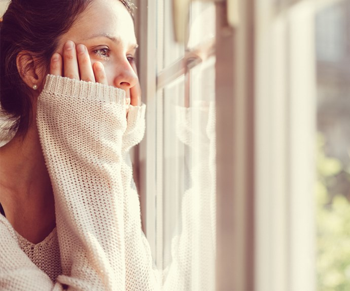 Bored woman looks out window