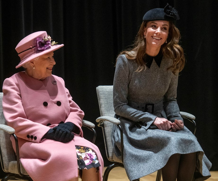 The Queen visiting King's College in late March with Duchess Catherine. It was Kate's first solo appearance with the Queen since marrying into the royal family in 2011. *(Image: Getty)*