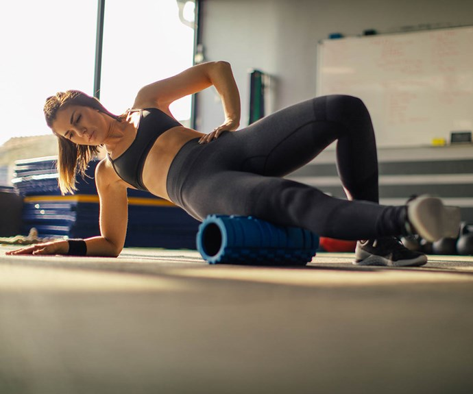 woman foam rolling exercise