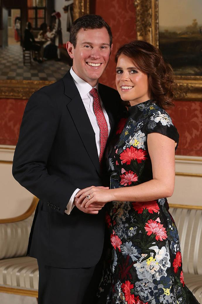 In an announcement that captured our hearts, Eugenie confirmed her engagement in January 2018 to her longtime boyfriend Jack Brooksbank, showing off a beautiful engagement ring. A padparadscha sapphire, the rarest of all sapphires, surrounded by a halo of diamonds, it was thought to be a tribute to her mother who became engaged with a near-identical ring in 1986. *(Image: Getty)*