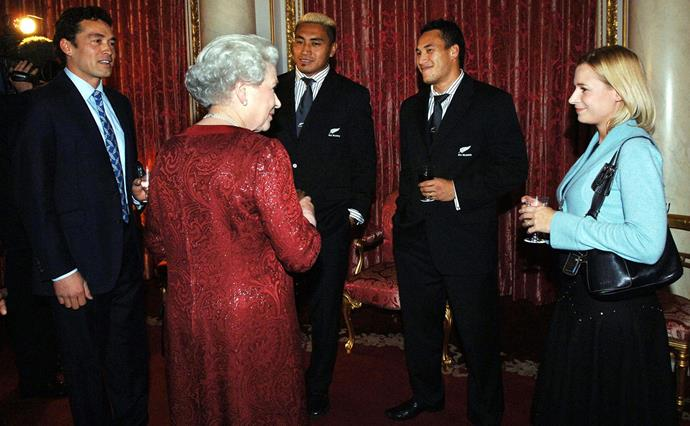 Gary and Lady Davina with the Queen and All Blacks Jerry Collins and Rico Gear at Buckingham Palace. *(Image: Getty)*