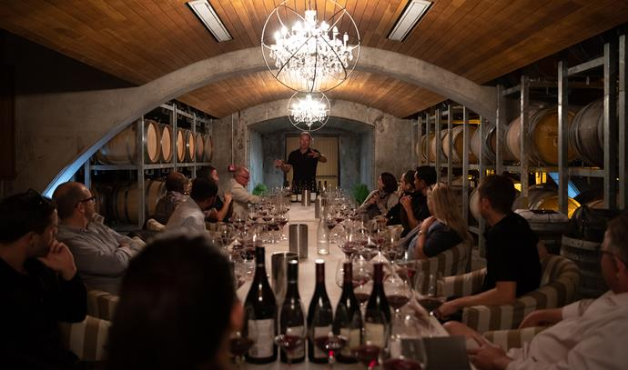 A pinot noir tasting is held in the cellar room.