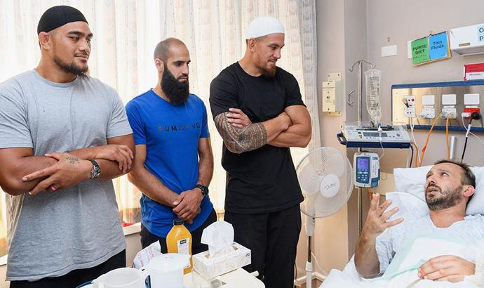 Ofa Tu'ungafasi (L) and Sonny Bill Williams (R) meet survivor Temel Atacocugu during a visit to Christchurch Hospital a week after the mosque terror attacks. *Image: Getty*