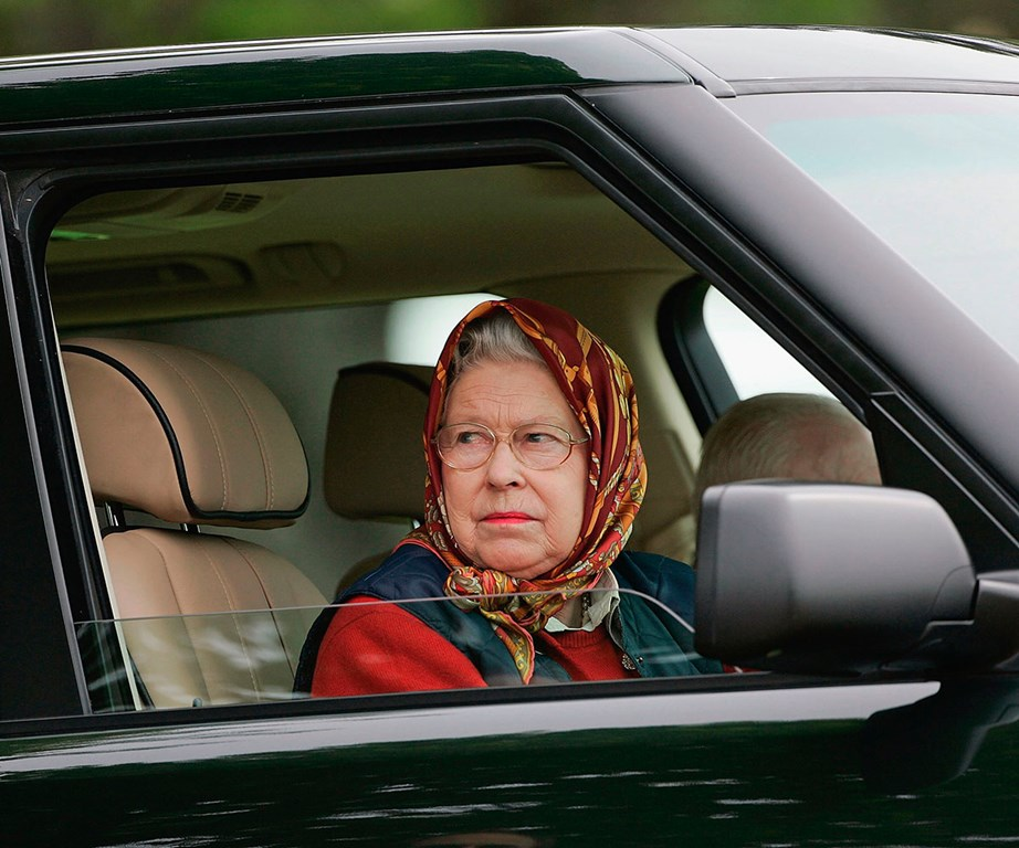 The Queen, dressed in a headscarf and tweed coat, was unrecognisable to the American tourists visiting Balmoral Castle. *(Image: Getty)*