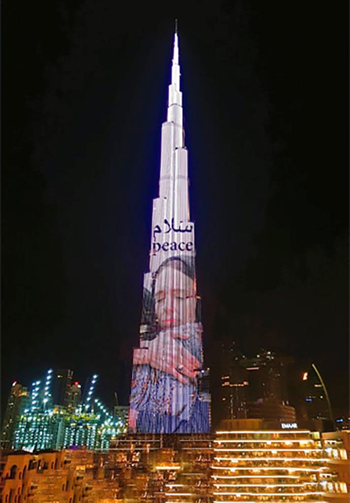 The image of Prime Minister Jacinda Ardern embracing Naima was projected high onto the side of the 163-storey Burj Khalifa in Dubai.