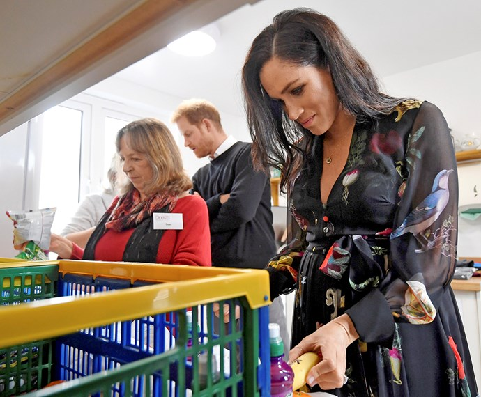 Meghan lends a hand packing care packages at charity One25 *Image: Getty Images*
