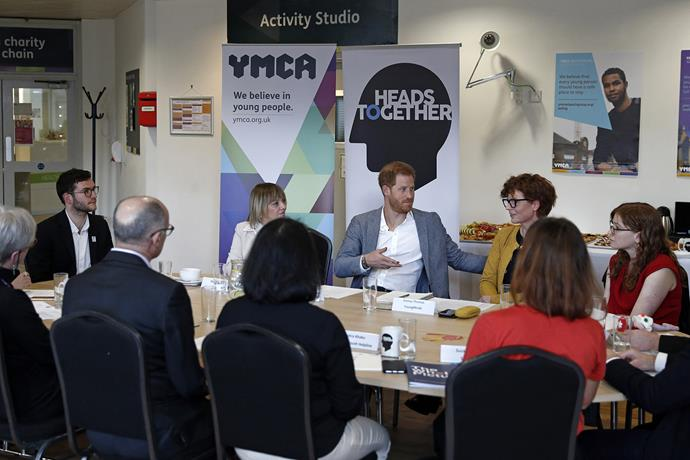 Prince Harry joins a roundtable discussion with mental health charities, convened by Heads Together. *(Image: Getty)*