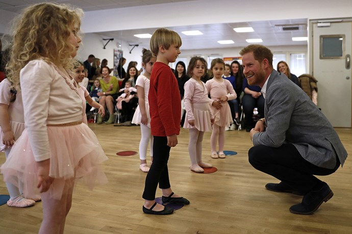 Prince Harry chats to children at a ballet class at the YMCA. *(Image: Getty)*