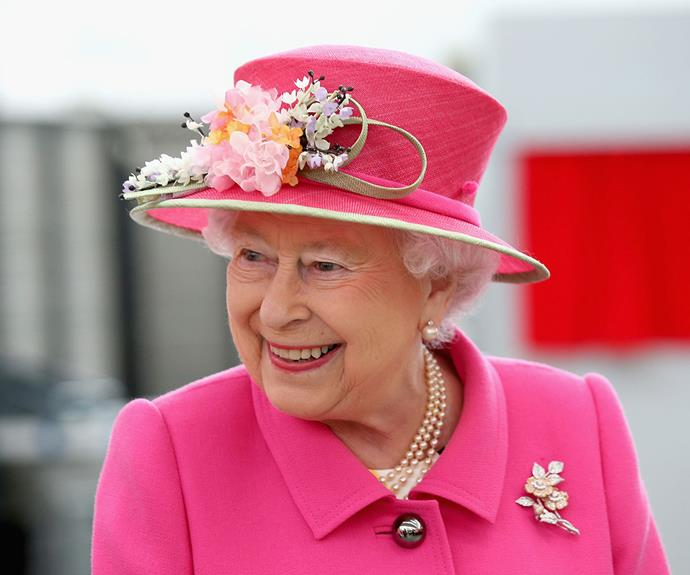 The Queen always wears bright colours so that she can be easily spotted in a crowd. She looks very fetching in pink