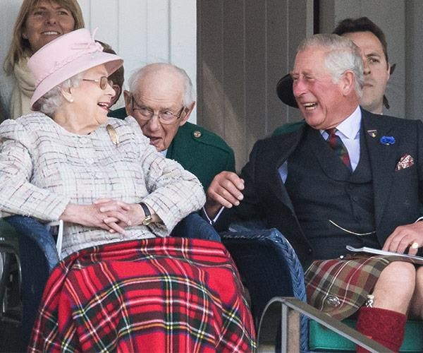 This image of the Queen having a rolicking good time with her son Prince Charles was taken during the Braemar Gathering in Braemar, Scotland in 2006.