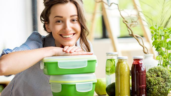 woman smiling with lunch boxes