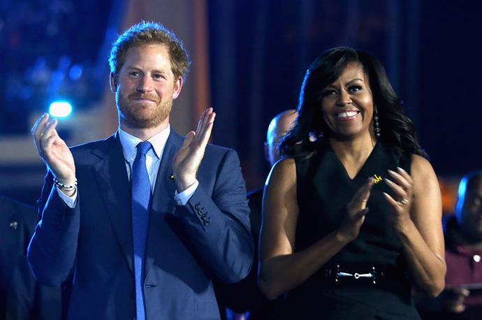 Prince Harry and Michelle Obama at the opening of the Invictus Games in Orlando, Florida in 2016. *(Image: Getty)*