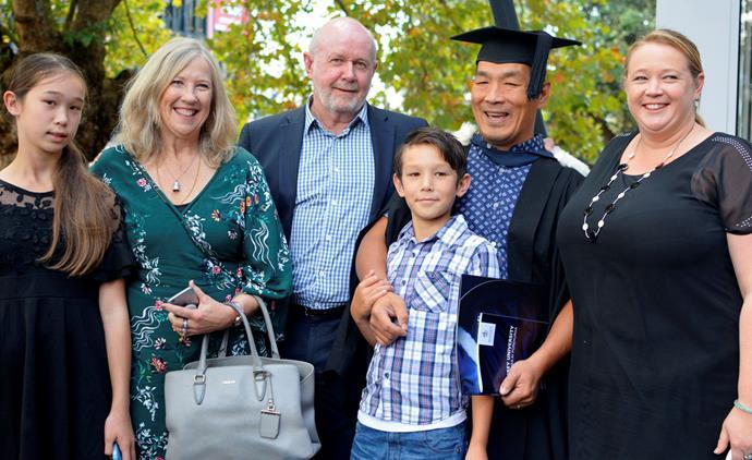 Esther, Barb, John, Tai, Hung and Heather celebrate his hard-won graduation.