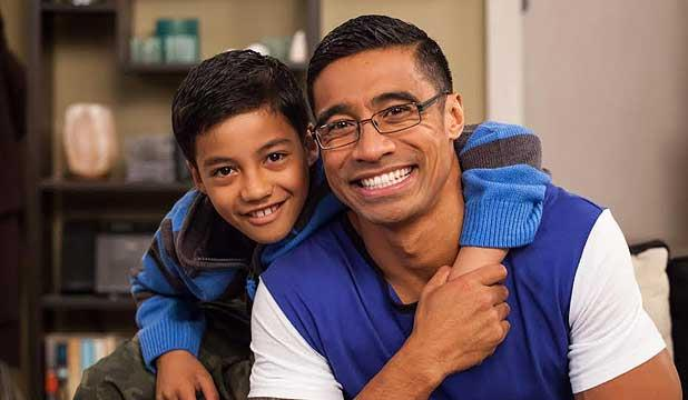 Pua on the set of *Shortland Street* with his on-screen son Michael, played by Duane Evans Jr.