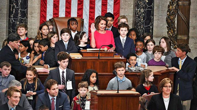 Nancy Pelosi and the kids of congress attend her swearing in. *Image: Getty*
