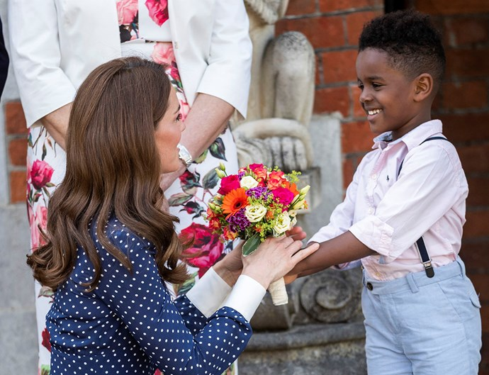 Duchess Kate is given a bouquet by a young fan while visiting Bletchley Park. *(Image: Getty)*