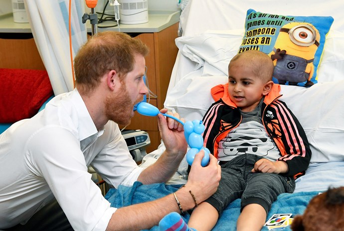 A young patient at Oxford Children's Hospital, Jay, gifted Prince Harry a balloon animal to give to Archie. *(Image: Getty)*