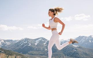blonde woman running in the mountains