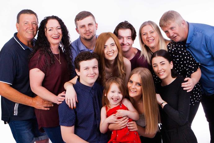 Krystal's beloved blended family (clockwise, from far left): Dad Darren, stepmum Therese, John-Paul, Luke, mum Ang, stepdad Paul, Lily-Jean, Grace, Harper-Rose and Sam.