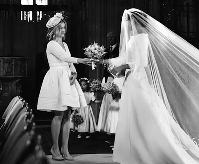 Clara hands Meghan her bouquet.