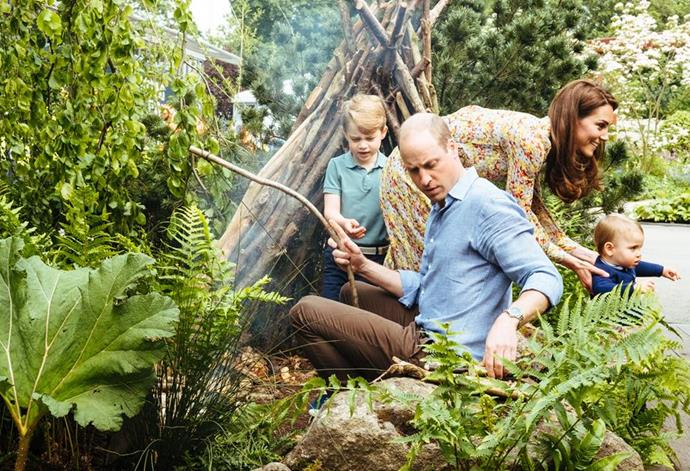 The Duke and Duchess of Cambridge build a campfire with Prince George and Prince Louis. *(Image: Matt Porteous / @KensingtonRoyal)*
