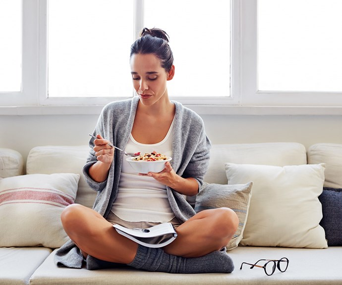 woman eating a bowl of muesli
