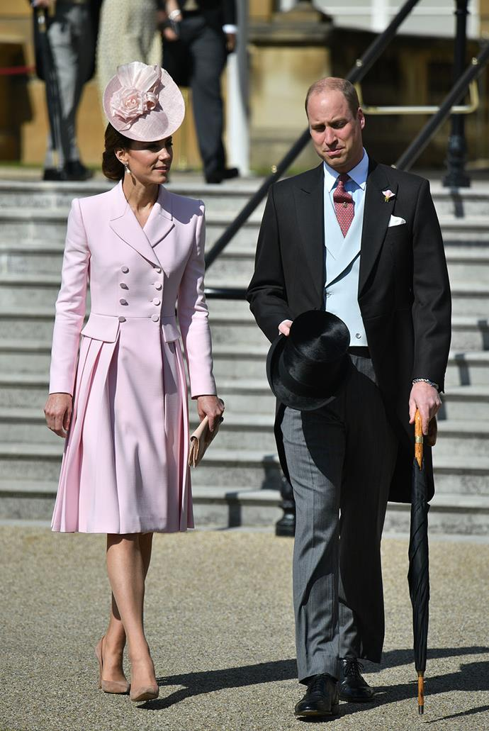 Kate looked gorgeous in a pastel pink Alexander McQueen coat dress. *(Image: Getty)*