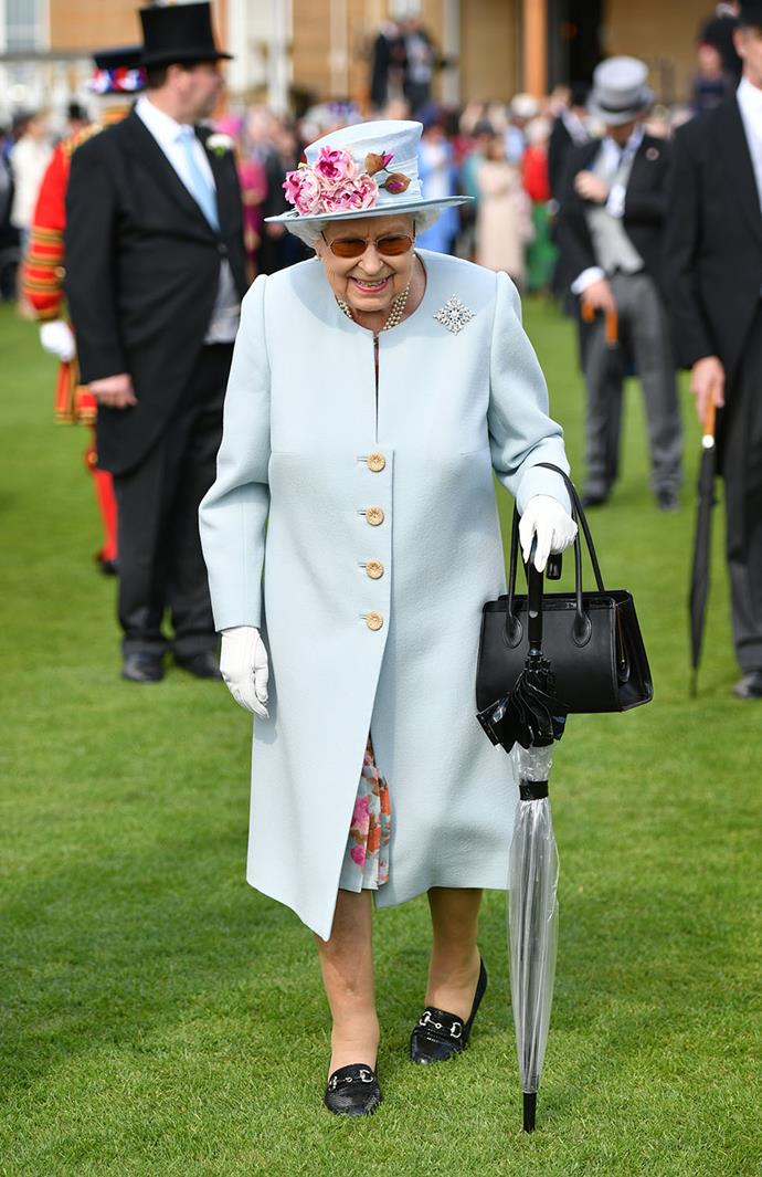 The Queen's outfit for Tuesday's garden party was true to her signature colourful style. *(Image: Getty)*