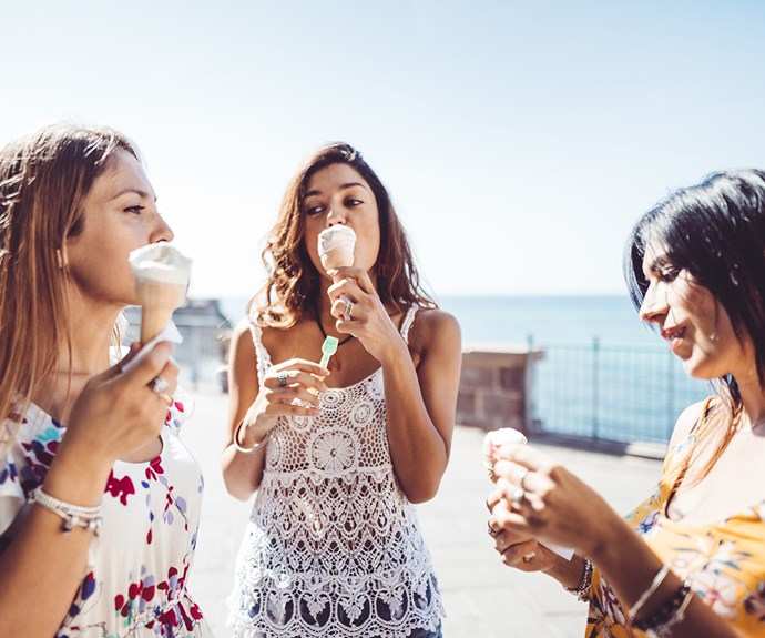 friends eating ice cream in summer