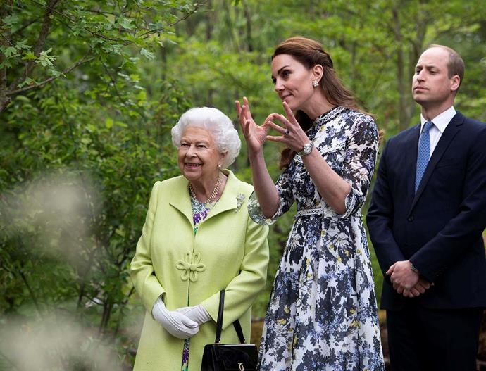 Duchess Catherine and Prince William show the Queen around the garden that Catherine co-created for the Chelsea Flower Show. *Image: Getty*
