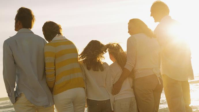 Family looking into horizon ocean sunset